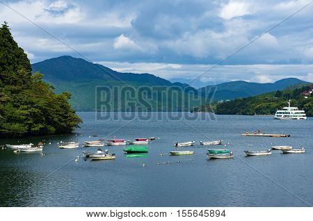 Colorful Fishing Boats With Mountains On The Background