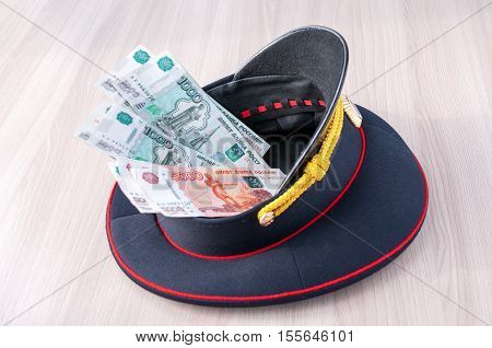 Bribe. Money lying in a police cap