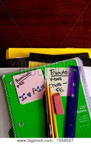 School Books And Supplies On Desk