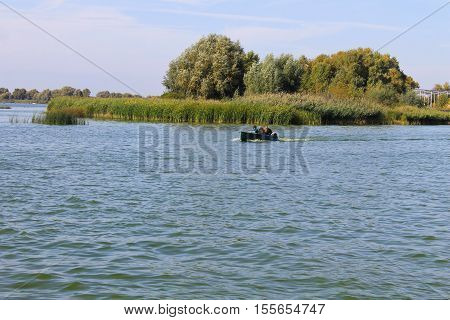 The motorboat floating in the river Dnieper