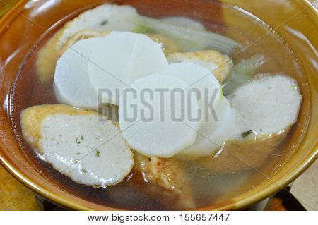 boiled radish and slice fish line hot soup on bowl