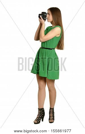 Young beautiful caucasian woman with camera over white background