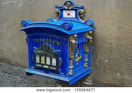 a blue old vintage postbox Germany public mailbox still in use
