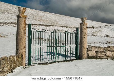Photo of gate for the paradise with snow