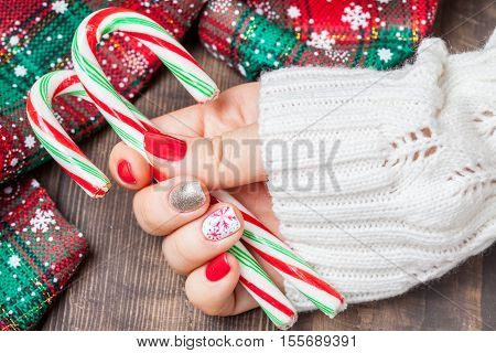 Christmas Nail art manicure. Winter Holiday style bright Manicure with gems Christmas tree and snowflakes