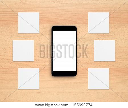 Smartphone and paper for notes on office desk