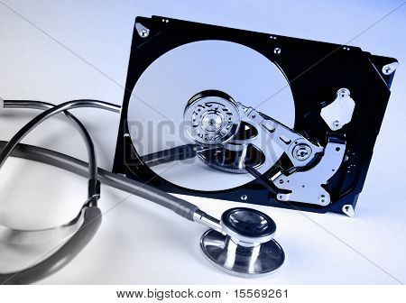 Computer hard drive and a stethoscope. The symbol of health equipment.