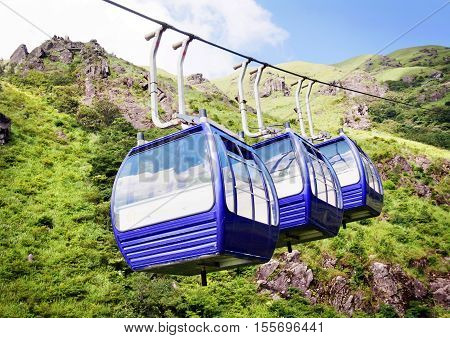The cable car between the numerous mountains.