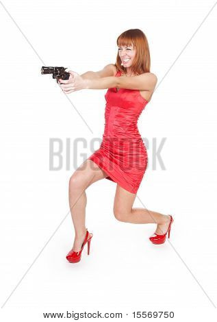 Beautiful woman in a red dress with a gun