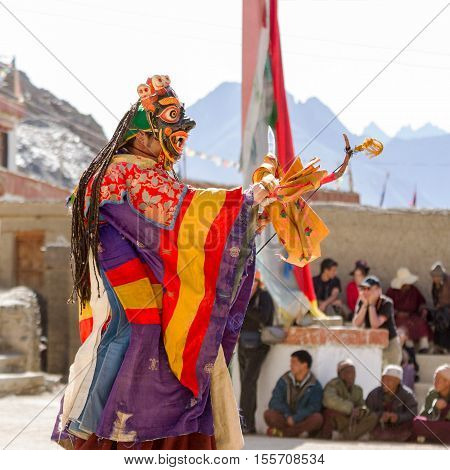 Unidentified monk in mask performs a religious masked and costumed mystery dance of Tibetan Buddhism during the Cham Dance Festival in Lamayuru monastery, India.