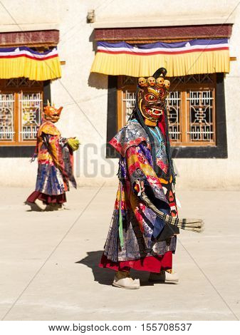 Unidentified monks in masks perform a religious masked and costumed mystery dance of Tibetan Buddhism during the Cham Dance Festival in Lamayuru monastery India.