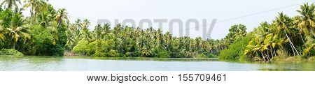 Panorama of Kerala backwaters - a chain of brackish lagoons and lakes lying parallel to the Arabian Sea coast in Kerala southern India