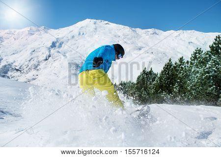 Snowboarder at a ski resort in winter