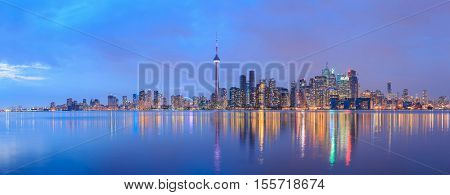 Scenic view at Toronto city waterfront skyline at twilight.