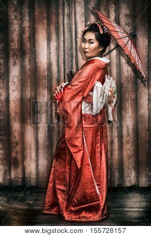 Woman In Traditional Japanese Kimono With Parasol