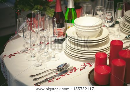 Festive Table Appointments. Christmas Table Layout, Preparation For Celebration. Round Table Covered