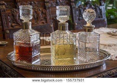 Photo of several bottles with several colours and selective focus