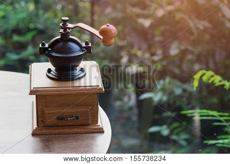 wooden traditional coffee maker on wooden table in coffee shop on natural view at relax coffee time / coffee maker