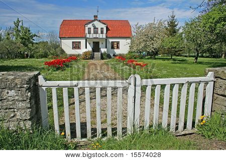 House With Red Roof And Big Garden
