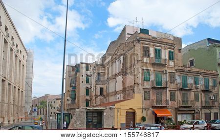 PALERMO ITALY - OCTOBER 2 2012: The old city districts are full of ruined residential buildings and slums neighboring with the monumental architecture on October 2 in Palermo.