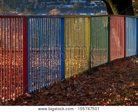 Brighty coloured metal railings at a childrens playground