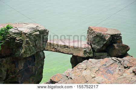 A stone bench over Lake Tai or Taihu scenic area on Turtle island in Wuxi China on a sunny day in Jiangsu province