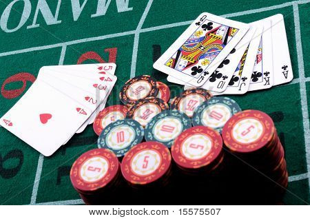 Place a poker player. chips and cards.