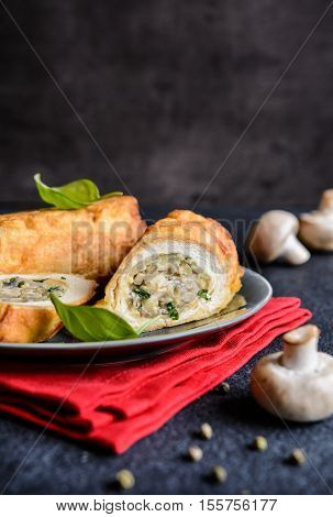 Fried Rolls Coated In Batter And Stuffed With Mushroom, Cheese, Onion And Parsley
