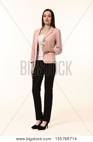 woman straight hair style in two pieces pink jacket trousers power pant suit high heels shoes full length body portrait standing isolated on white