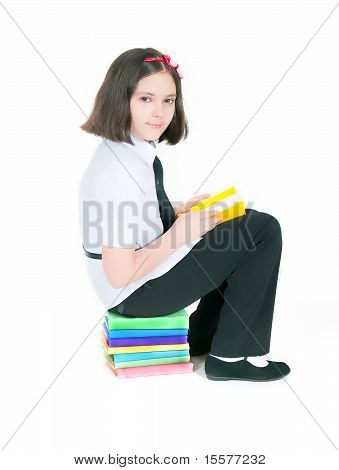 Girl Sitting On A Stack Of Books