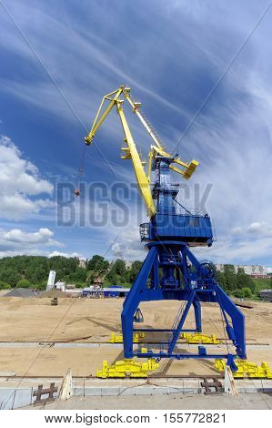 Gorodets, Russia. - June 2.2016. Blue Portal Crane With A Yellow Arrow On The Cargo Wharf In Gorodet