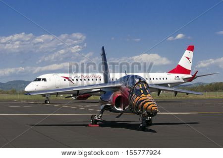 Maribor, Slovenia - April 16, 2016: Red Bull Alpha Jet In Front And Austrian Airlines Embraer Oe-lwd