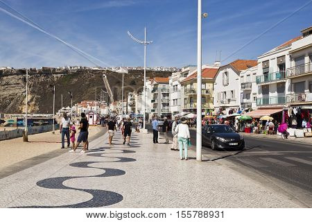 NAZARE, PORTUGAL - September 12, 2016: View of the very popular with tourists beachfront avenue in the fishing village of Nazare Portugal