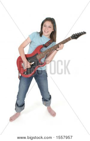Young Pre Teen Girl Playing Guitar 3