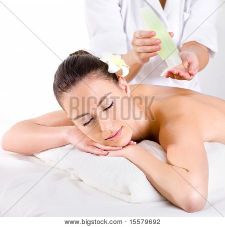 Heathy Massage For Young Woman With Aromatic Oils