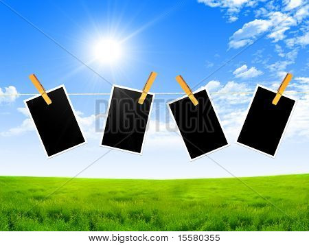 Dark frame with a pin against the blue sky and bright sun