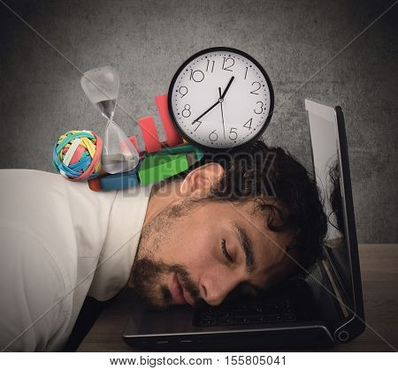 Businessman exhausted from business crisis sleeping over computer
