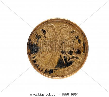 isolated on white background old Russian ruble coin is covered with rust and black crust