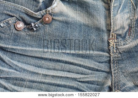 Denim jeans texture or denim jeans background with seam zipper and pocket. Old grunge vintage denim jeans. Stitched texture denim jeans background of fashion jeans design.