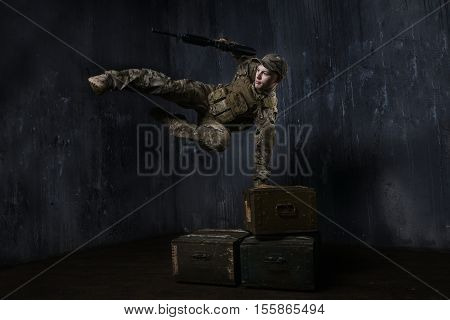 Training soldier. Soldier jumping over boxes of ammunition.Around the world those guys keep us safe