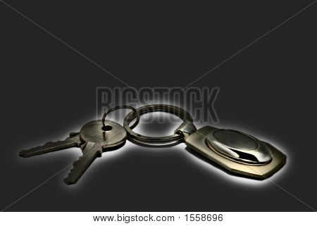 Two Keys On A Charm With Effect Gold  Luminosity