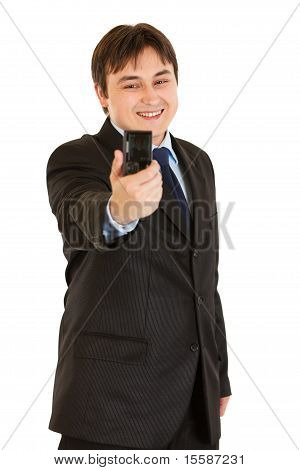 Laughing modern young businessman photographing himself isolated on white