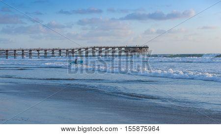 California coast. San Diego beach at sunset. Ocean Waves rolled on the sand