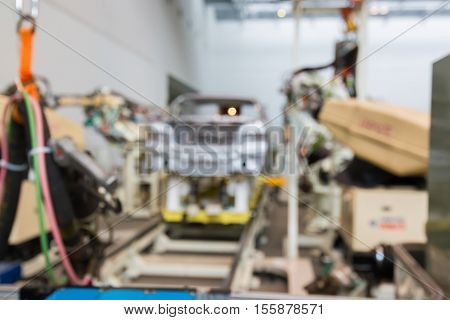 Abstract Blurred Background Interior Of Car Production Factory By Machine And Robot Automaton.