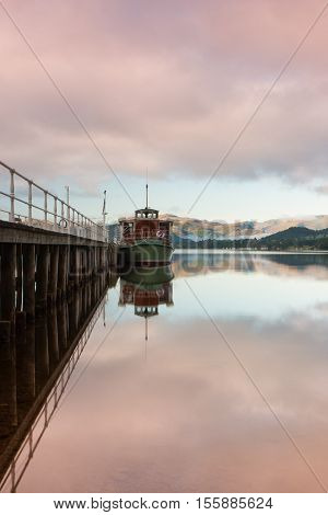Steamboat docked on Ullswater in the Lake District in Cumbria England