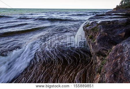 Coastal Waterfall On The Shores Of Lake Superior. Elliot Falls is a waterfall on the shores of Lake Superior in Michigan's Pictured Rocks National Lakeshore. Munising, Michigan.
