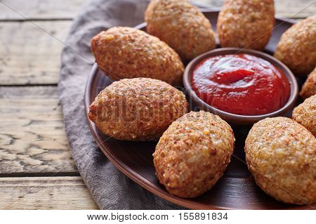 Kibbeh traditional middle eastern Levantine restaurant lamb goat or camel meat stuffed bulgur kofta spicy meatball croquettes food on vintage wooden table background