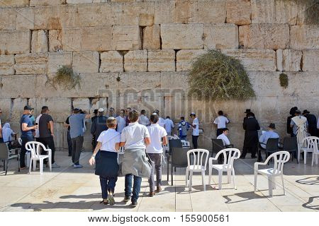 JERUSALEM ISRAEL 26 10 16: People pray a the Western Wall, Wailing Wall or Kotel the Place of Weeping is an ancient limestone wall in the Old City of Jerusalem. Second Jewish Temple by Herod the Great