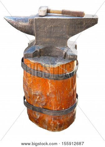 Anvil On A Brown Pedestal With A Hammer Isolated Over White