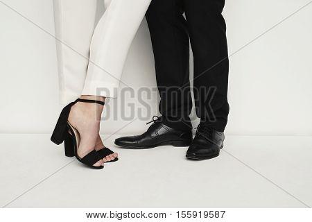 Couple in footwear fashion low section studio shot